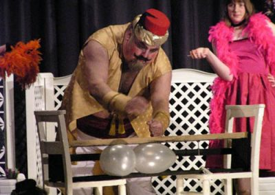 Ian Smith as the strongman with assistant Jenny Davidson