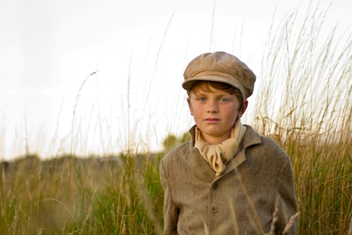 Alfie Lewis as Young Pip in a publicity still