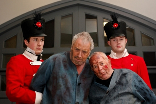 Soldiers Dom McAndrew and David Asher arrest convicts Magwitch (John Beverley) and Compeyson (John Leighton)