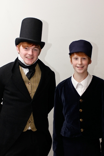 Herbert (Adrian Snow) and his young alter ego (Jacob Grantham)