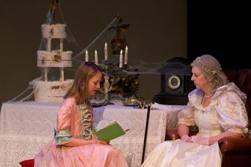 Young Estella (Emma Street) reads to Miss Havisham (Janet Marshall)