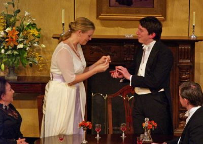 Gerald Croft (Stephen Gillard) shows the engagement ring to Sheila Birling (Nicola Stocks)
