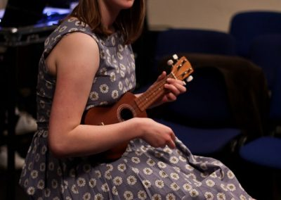 Emily Ashberry providing interval entertainment with her ukulele