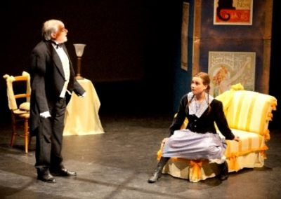 Victor the valet (Christopher Adams) gives Gigi (Megan Brewer) the benefit of his wisdom