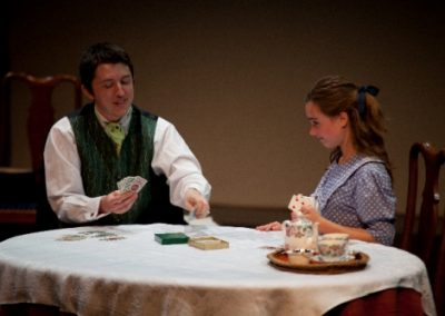 Gaston (Steve Gillard) and Gigi (Megan Brewer) play cards
