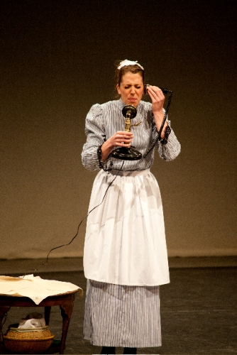 Sidonie the maid (Holly Eggboro) tries to get used to the new fangled telephone