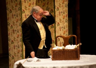 Victor the valet (Christopher Adams) organises the champagne