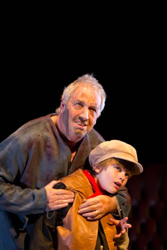 Young Pip (Alfie Lewis) is seized on the lonely marshes by Magwitch (John Beverley)
