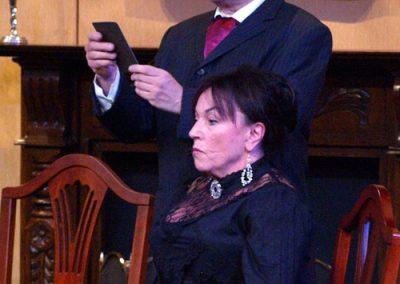 Inspector Goole (Christopher Adams) produces a photograph