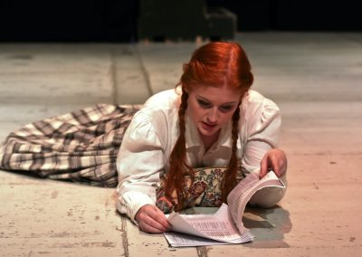 Jo (Ellie Pickering) working on her book
