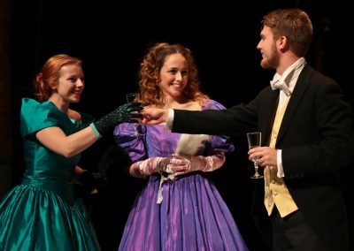 Meg (Jessica Hocking), Sallie Gardiner (Lucie Evans) and Fred Vaughan (Joshua Pearson) at the party