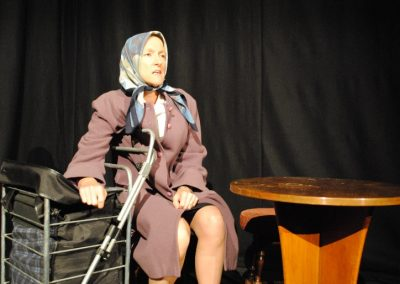 Julie Charlton as the Old Woman